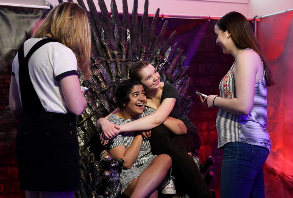 Laughing it up on the Iron Throne