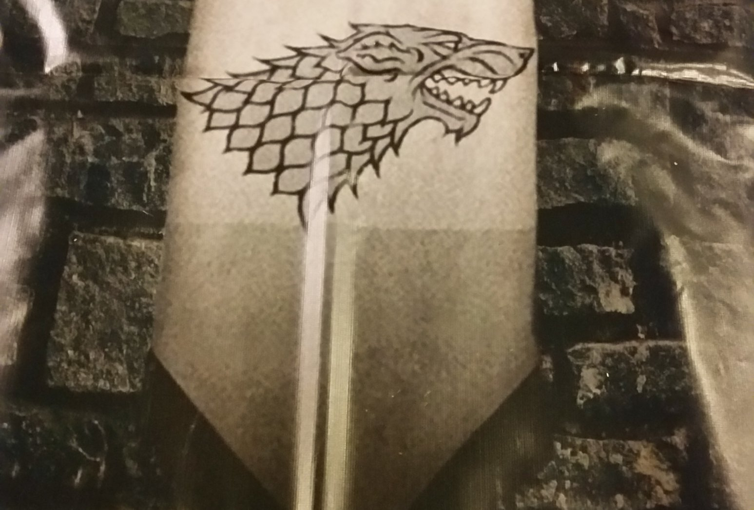 Stark banner wall covering
